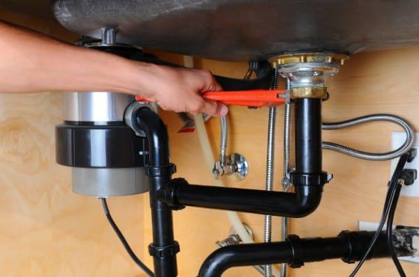 Plumber Fixing Leak