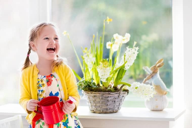Little Girl Watering Plant